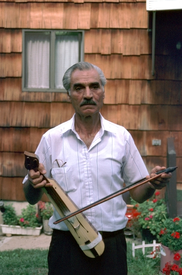 Ilias Kementzides outside his house, Norwalk, Connecticut, 1991, photograph by Alan Govenar