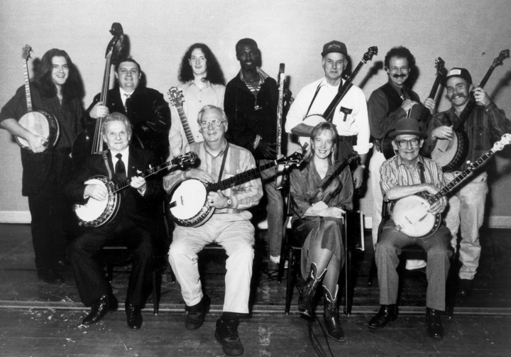 1993 Masters of the Banjo tour. Standing, from  left: Seamus Egan, Jimmy Trivette, John Doyle, Seleshe Damessae, Carroll Best, Dudley Connell, Kirk Sutphin; seated, from left: Ralph Stanley, Tony Ellis, Laurie Lewis, Will Keys. Photograph by James V. Gleason, courtesy National Council for the Traditional Arts