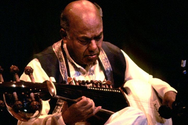 Ali Akbar Khan plays the sarod, a twenty-five-string instrument indigenous to his native India. He learned more than 75,000 ragas, or melodic motifs, from his father. Photograph by Kamal Bakshi, courtesy National Endowment for the Arts