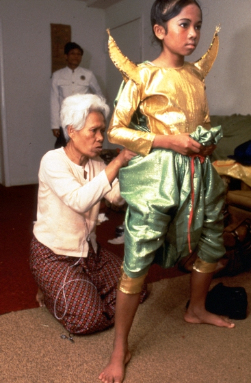 Peou Khatna (left) became a choreographer, dance instructor and costumer when she retired from performing as a dancer in Cambodia. After immigrating to the United States and settling in Maryland, she organized her own troupe, improvising costumes and re-creating Khmer dances from memory. Photograph by Dexter Hodges, courtesy National Endowment for the Arts
