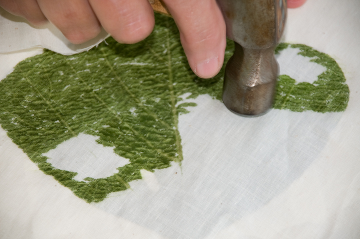 Bettye Kimbrell pounding a kudzu leaf to extract the dye. This technique, Bettye says, is called 'Cherokee leaf pounding,' Mt. Olive, Alabama, 2008, photograph by Alan Govenar