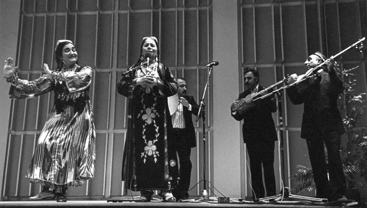 Shashmaqam, Fatima Kuinova (center) with Shumiel Kuyenov (*doira*), Borukhay Daurayev (*tar*) and Arkedy Davidov (*tar*), \photograph by Jack Vartoogian