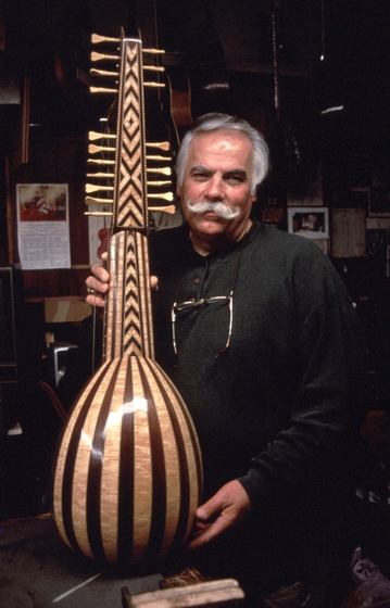 Peter Kyvelos with one-of-a-kind arch lute (perennially on display in his shop), Belmont, Massachusetts, courtesy National Endowment for the Arts