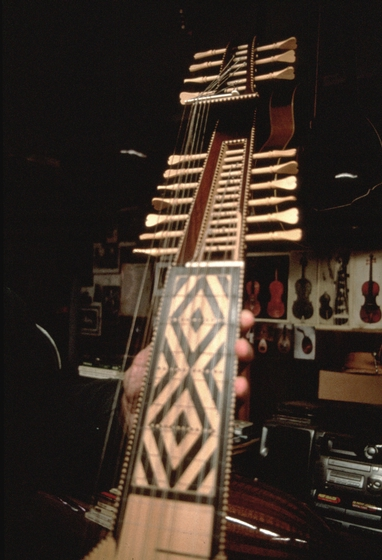 Wood inlaid neck and peg box for arch lute made by Peter Kyvelos, courtesy National Endowment for the Arts