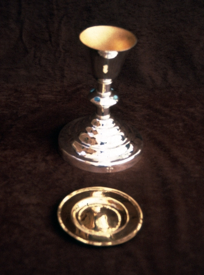 "Silver and gold chalice by Ramón José López, hand-raised from 16 gauge silver with 24K gold plating paten, 1988, courtesy National Endowment for the Arts. Chalice: 10"" x 6"" diameter at base x 4"" diameter at top. Paten: 1/4"" x 6"""