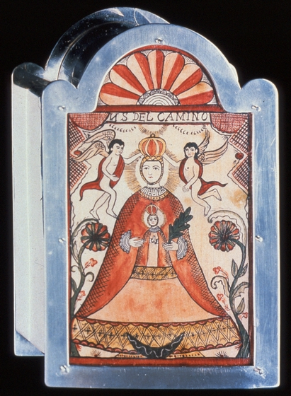 "'Nuestra Señora del Camino', *escudo* (reliquary) by  Ramón José López. Box and frame: hand-fabricated sterling silver, riveted and soldered. Miniature *retablo*: hand-adzed pine panel, gesso, polychrome. Sheet mica glazing fits in the frame to cover the *retablo*, 6"" x 3 1/2"" x 1"" courtesy National Endowment for the Arts"