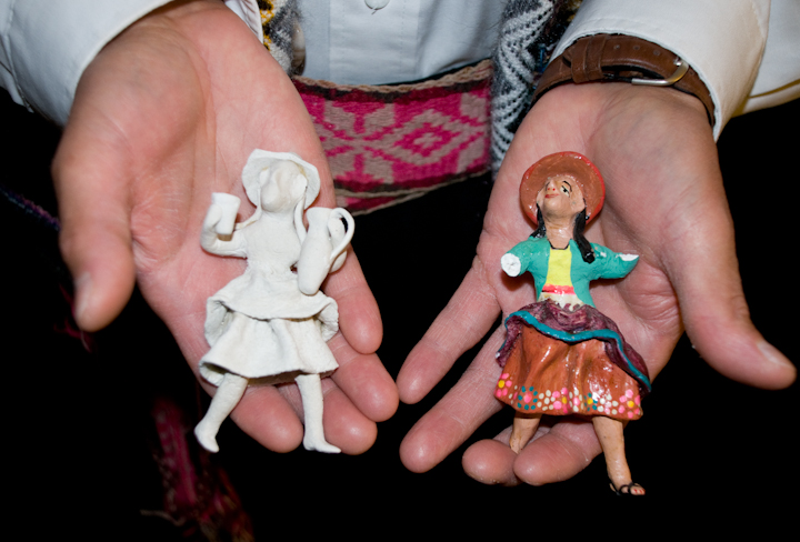 *Retablo* figures in the hands of Jeronimo E. Lozano, Bethesda, Maryland, 2008, photograph by Alan Govenar
