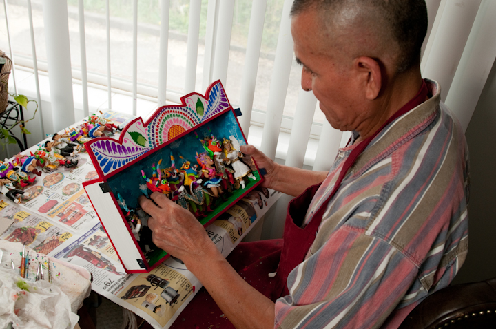 Jeronimo E. Lozano making *retablos* in his apartment, Salt Lake City, Utah, 2009, photograph by Alan Govenar