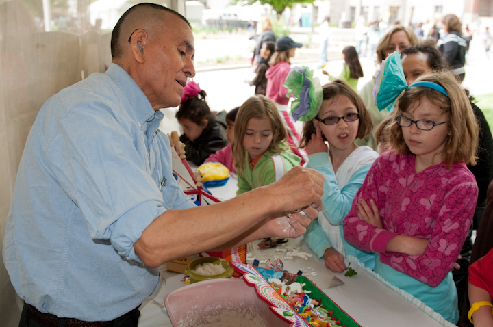 Jeronimo E. Lozano demonstrating the making of *retablos*, Living Traditions Festival, Salt Lake City, Utah, 2009, photograph by Alan Govenar