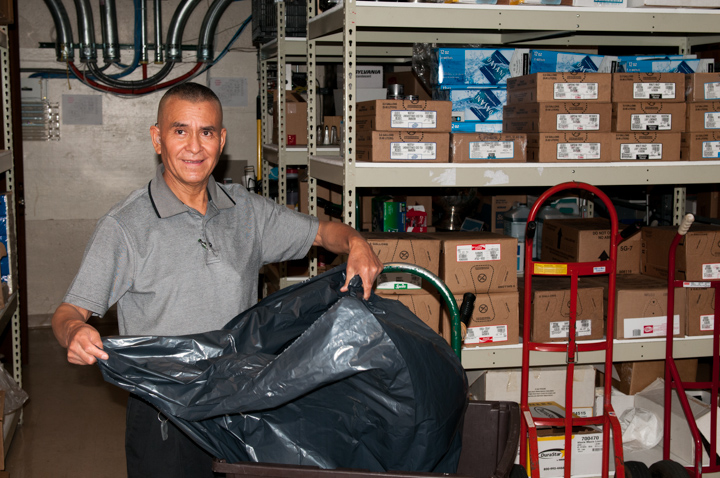 Jeronimo E. Lozano at his job as a janitor, Salt Lake City, Utah, 2009, photograph by Alan Govenar