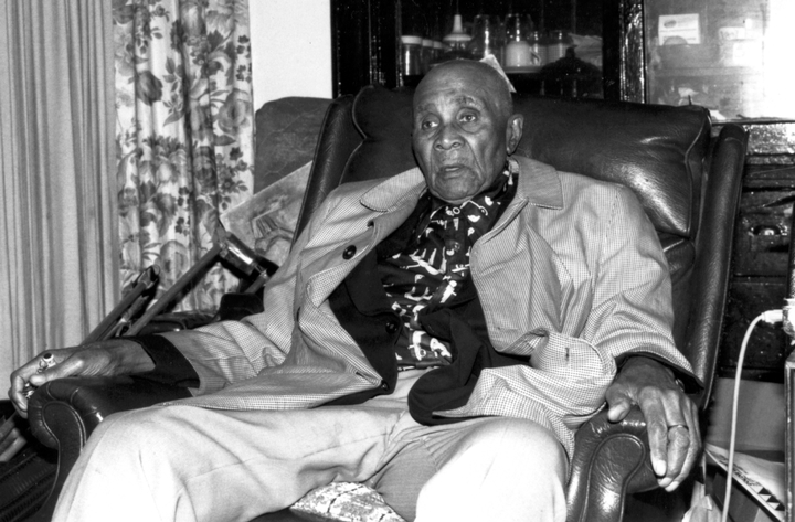 Albert 'Sunnyland Slim' Luandrew at age 84 in his apartment, Chicago, Illinois, 1991, photograph by Alan Govenar