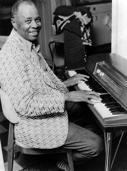 "Blues pianist and singer Albert ""Sunnyland Slim"" Luandrew grew up in Mississippi and followed the African American migration north looking for a better life. In time, he became a mainstay of the Chicago blues scene. ""I lay it down hard on the piano,"" he said of his barrelhouse style. Courtesy Airway Records and National Endowment for the Arts"