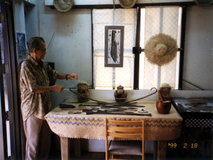 Joaquin Lujan displaying tools used in his Chamorro village shop, courtesy Joaquin Lujan
