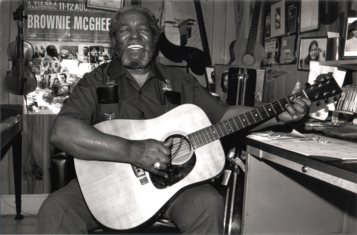 Brownie McGhee became a well-known blues musician, both through solo performances and his longtime partnership with harmonica player Sonny Terry. McGhee developed his own style of intricate fingerpicking. Oakland, California, 1990, photograph by Alan Govenar
