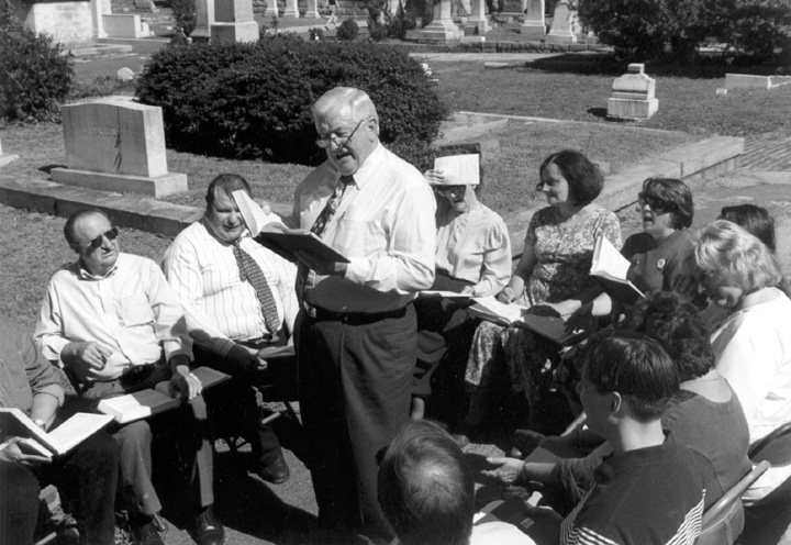 Hugh McGraw leads Sacred Harp singing at Atlanta's Oakland Cemetery, where B.F. White, co-author of *The Sacred Harp* is buried, Photograph by Aimée Schmidt,courtesy Georgia Council on the Arts