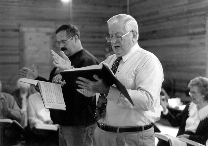 """Hugh McGraw has dedicated much of his life to the preservation of Sacred Harp music, religious songs written in the shape-note system of musical notation. He  grew up with the music but didn't really get involved until 1952, when """"I began studying and teaching, composing and singing this music all over the country."""" Photograph by Aimée Schmidt, courtesy Georgia Council for the Arts"""