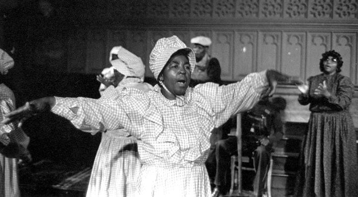 """The McIntosh County Shouters are among the last practitioners of the """"shout"""" or """"ring shout."""" Associated with burial rituals in West Africa, it persisted during and after slavery in the United States. Here, they are performing in New York City. 1987, photograph by Jack Vartoogian"""