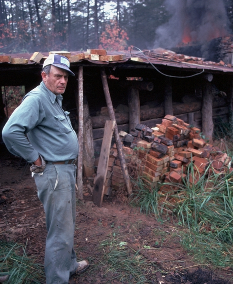 Lanier Meaders maintained the regional ceramic tradition of Mossy Creek, Georgia. He made alkaline-glazed stoneware, working alone with a foot-powered treadle wheel and a wood-fired kiln. 1982, photograph by T. Jackson, courtesy Ralph Rinzler Folklife Archives and Collections, Center for Folklife and Cultural Heritage, Smithsonian Institution