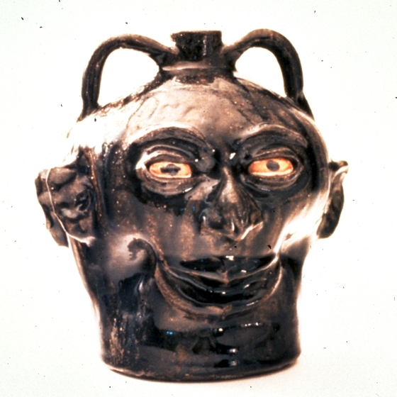 "Face jug by Lanier Meaders, alkaline-glazed stoneware, 9 1/2"" high, 1975, photograph by Michel Monteaux, courtesy Museum of International Folk Art (a unit of the Museum of New Mexico)"