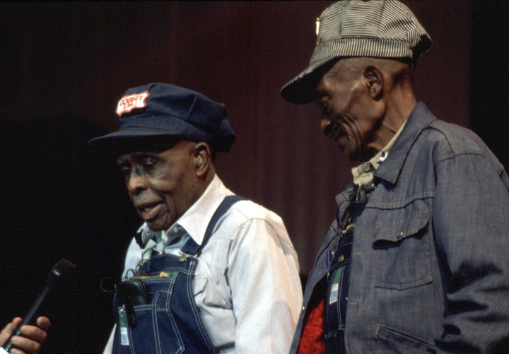 John Mealing (left) and Cornelius Wright, Jr., led railroad workers known as gandy dancers in songs and chants as they laid and maintained track. The tradition died out in the 1960s, and both men devoted much of their time in retirement to keeping it alive. 1996 National Heritage Fellowship Concert, courtesy National Endowment for the Arts