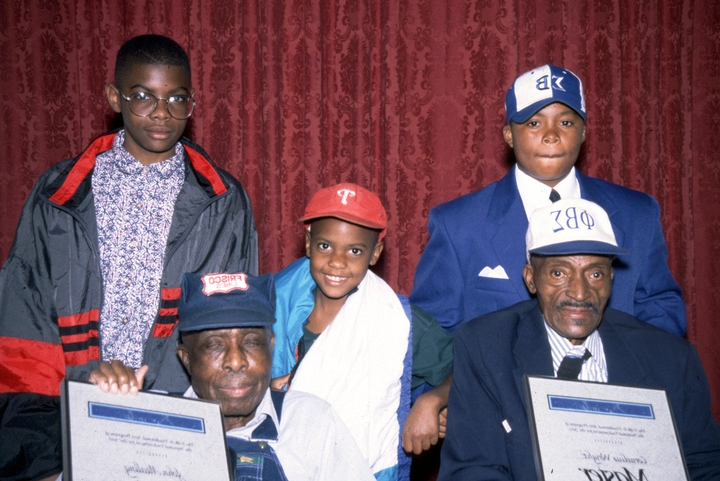 John Mealing and Cornelius Wright, Jr. (seated front) with family members, 1996 National Heritage Fellowship Ceremonies, courtesy National Endowment for the Arts