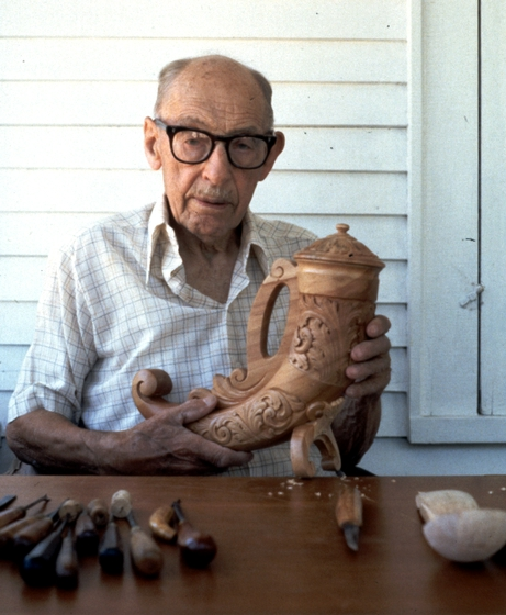 Leif Melgaard carving his horn of plenty, photograph by Phil Nusbaum, Courtesy Minnesota State Arts Board