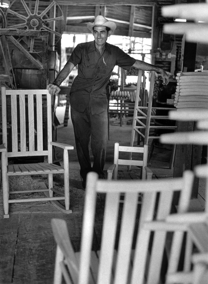 D.L. Menard with his hand-crafted rocking chairs, Erath, Louisiana, 1975, photograph by Nicholas R. Spitzer