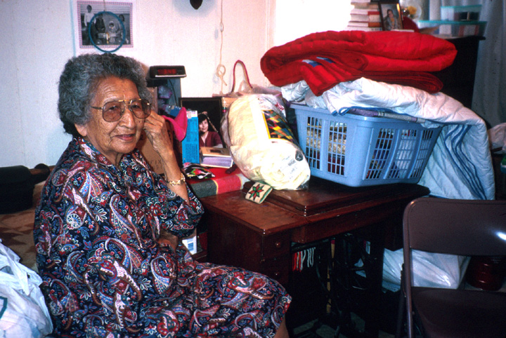 Nellie Star Boy Menard at home with her quilting supplies, Rosebud, South Dakota, June 1993. Photograph by Marsha MacDowell, courtesy Michigan Traditional Arts Program, Michigan State University Museum
