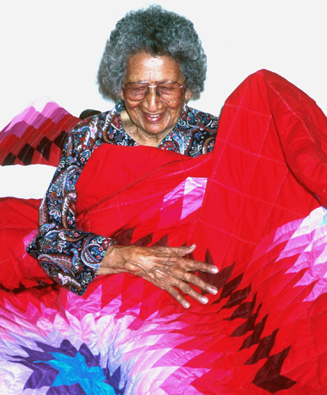 Nellie Star Boy Menard with one of her star quilts (detail), Rosebud, South Dakota, June 1993. Photograph by Marsha MacDowell, courtesy Michigan Traditional Arts Program, Michigan State University Museum