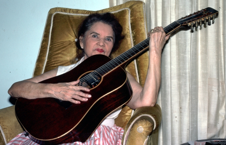 Lydia Mendoza in her living room, Houston, Texas, 1991, photograph by Alan Govenar