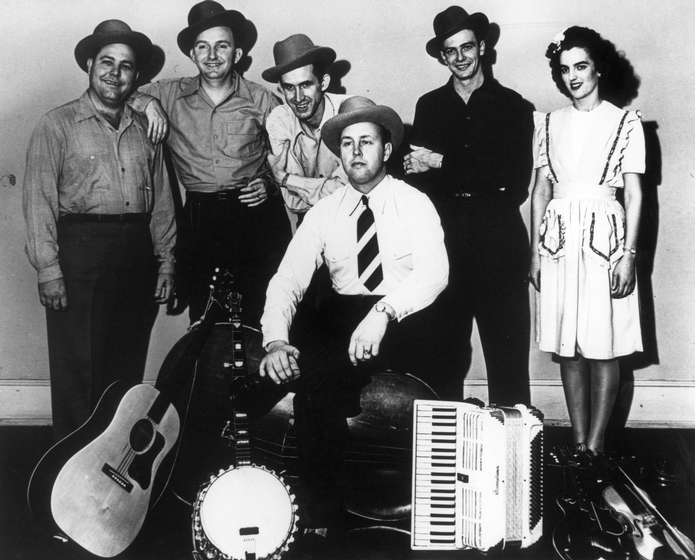Bill Monroe and his Blue Grass Boys (left to right): Chubby Wise, Lester Flatt, Stringbean (David Akeman), Bill Monroe (seated), Andy Boyett, Sally Forrester, ca. 1945, courtesy Smithsonian Institution and Country Music Foundation Library Media Center, Nashville, Tennessee