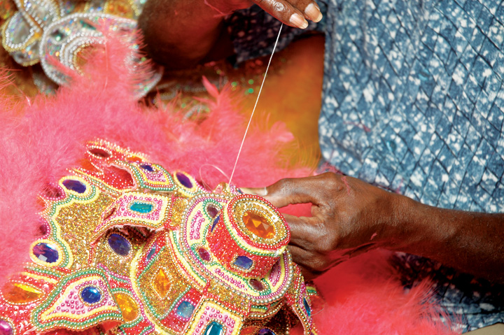 Allison 'Tootie' Montana sewing the apron of one of his older Mardi Gras Indian suits, New Orleans, Louisiana, 2004, Photograph by Alan Govenar