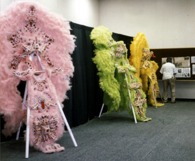 Allison 'Tootie' Montana with Mardi Gras Indian suits on display at the Essence Festival, New Orleans, Louisiana, 1995, Courtesy Joyce Montana