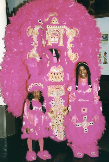 In front of one of Allison 'Tootie' Montana's suits is granddaughter Chelsi Stevenson and grandson Chantz Stevenson' Mardi Gras, New Orleans, Louisiana, 1994, Courtesy Joyce Montana