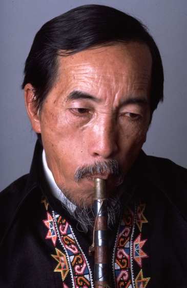 Bua Xou Mua playing the *gaeng* (reed mouth organ), 1985 National Heritage Ceremonies, courtesy National Endowment for the Arts