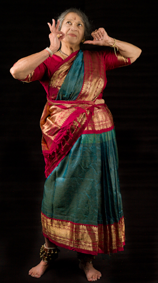 Kamala Lakshmi Narayanan is recognized as the foremost proponent of Bharatanatyam, a South Indian classical dance form that combines artistic expression with rhythmic footwork. Here she demonstrates *Shringara* (love), one of the nine *rasas* (emotions) known as the *navarasas*. Bethesda, Maryland, September 24, 2010, photograph by Alan Govenar