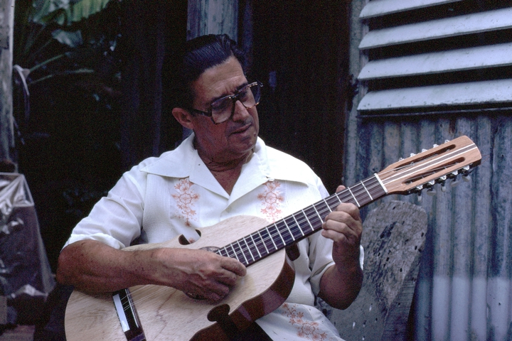 Julio Negrón-Rivera playing the *cuatro*. Photograph by Walter Murray Chiesa, Morovis, Puerto Rico, courtesy National Endowment for the Arts