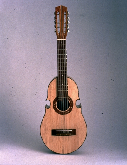 "*Cuatro*, ten-string guitar, by Julio Negrón-Rivera, jaguey wood, 34"" long, Morovis, Puerto Rico, 1988. Photograph by Michel Monteaux, courtesy Museum of International Folk Art (a unit of the Museum of New Mexico)"