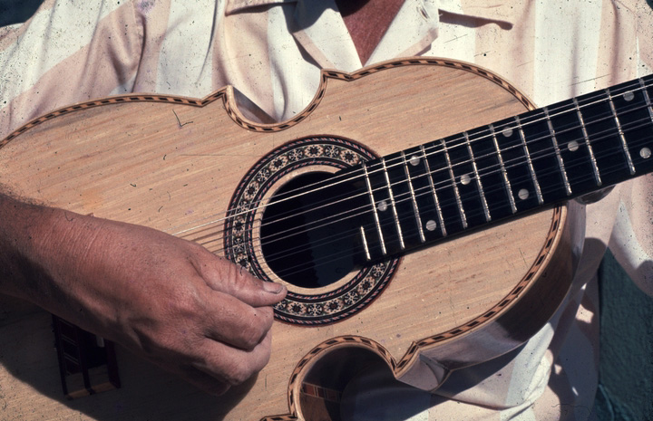 Julio Negrón-Rivera playing the *cuatro* (ten-string guitar), photograph by Walter Murray Chiesa Morovis, Puerto Rico, courtesy National Endowment for the Arts