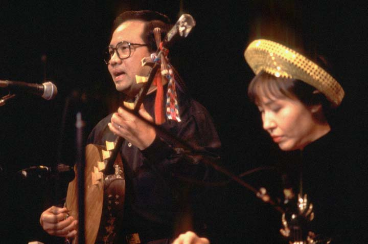 Phong Nguyen playing the Vietnamese *dan nguyet* lute with Tuyen Tonnu (a member of the Phong Nguyen Ensemble) playing the *dan tranh* zither, 1997 National Fellowship Ceremonies, courtesy National Endowment for the Arts