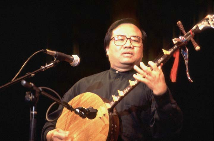 Phong Nguyen playing the Vietnamese *dan nguyet* lute, 1997 National Fellowship Ceremonies, courtesy National Endowment for the Arts