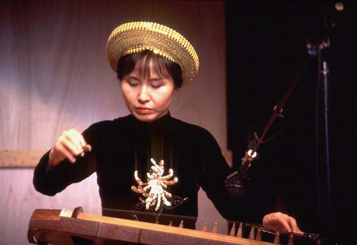Tuyen Tonnu (a member of the Phong Nguyen Ensemble) playing the *dan tranh* zither, 1997 National Fellowship Ceremonies, courtesy National Endowment for the Arts