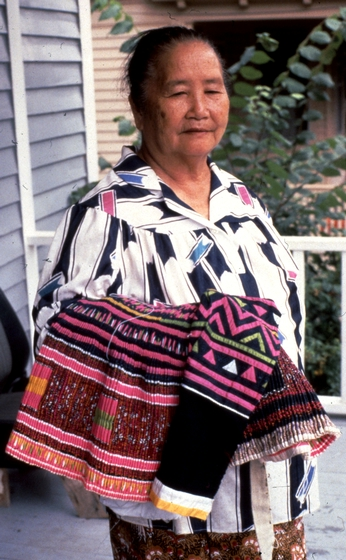 Yang Fang Nhu learned to weave while growing up in a small Hmong village in northern Laos and used the skill to make clothing for her family and others in the community. She resumed weaving after immigrating to the United States. Providence, Rhode Island, 1985, photograph by Winifred Lambrecht, courtesy Rhode Island State Council on the Arts