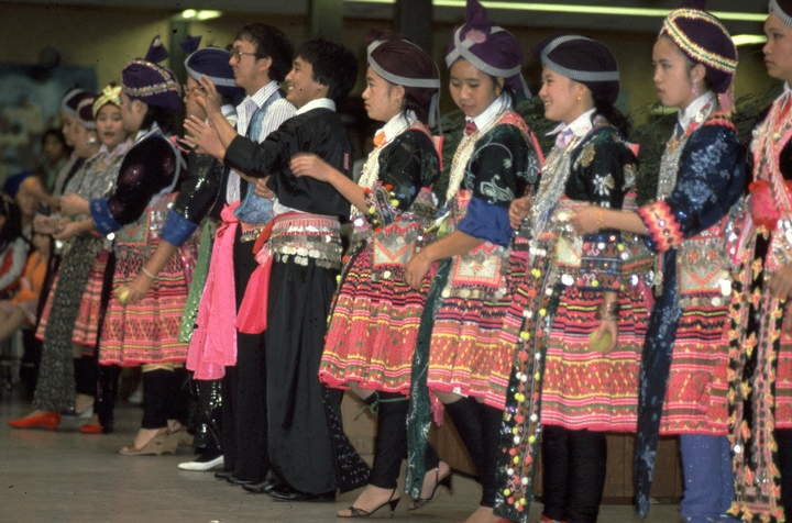 Hmong troupe with garments made by Yang Fang Nhu, photograph by Winifred Lambrecht, courtesy Rhode Island State Council on the Arts