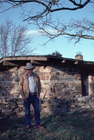 Glenn Orhlin outside the house he built in Mountain View, Arkansas, 1991, photograph by Alan Govenar