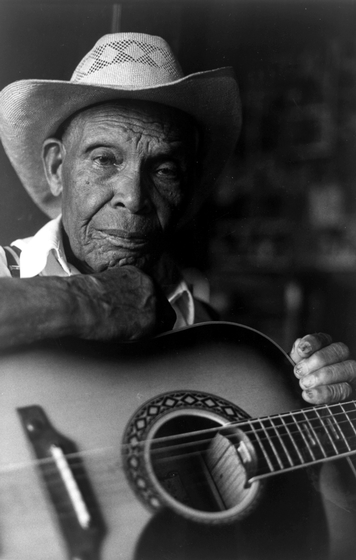 "Jack Owens of Bentonia, Mississippi, was a sharecropper who operated a small ""juke house"" on weekends. He played and sang blues for his patrons and in later years sometimes performed at festivals around the country. Photograph by Axel Kustner, courtesy National Endowment for the Arts"