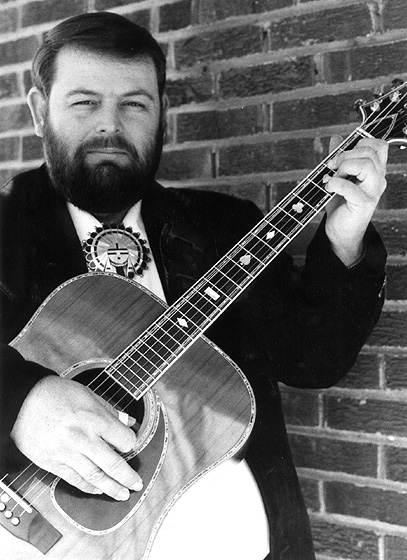 Eddie Pennington began playing the guitar at 11. When he was 18, he heard Merle Travis and decided to devote himself to Travis' complex technique called thumb picking, in which the thumb keeps a regular rolling rhythm while the fingers pick the melody. Photograph by Joseph T. Wilson, courtesy National Council for the Traditional Arts