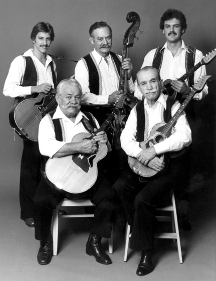 Adam Popovich (seated, right) played for years in the Popovich Brothers Tamburitza Orchestra. Also seated is Ted Popovich. Standing (from left) are Johnny Lazich, Pete Mistovic and Bobby Lalich. Courtesy Center for Traditional Music and Dance and Ralph Rinzler Folklife Archives and Collections, Center for Folklife and Cultural Heritage, Smithsonian Institution