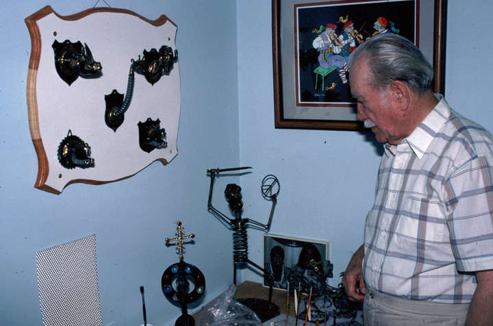 Adam Popovich with pieces of his metalwork, Dolton, Illinois, 1991, photograph by Alan Govenar