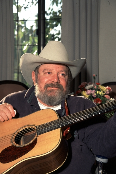 Cowboy singer and poet Buck Ramsey turned to writing to make a living after a fall from a horse in 1963 put him in a wheelchair. He learned to play the guitar and often performed his works in public. 1995 National Heritage Fellowship Ceremonies, photograph by James V. Gleason, courtesy National Endowment for the Arts